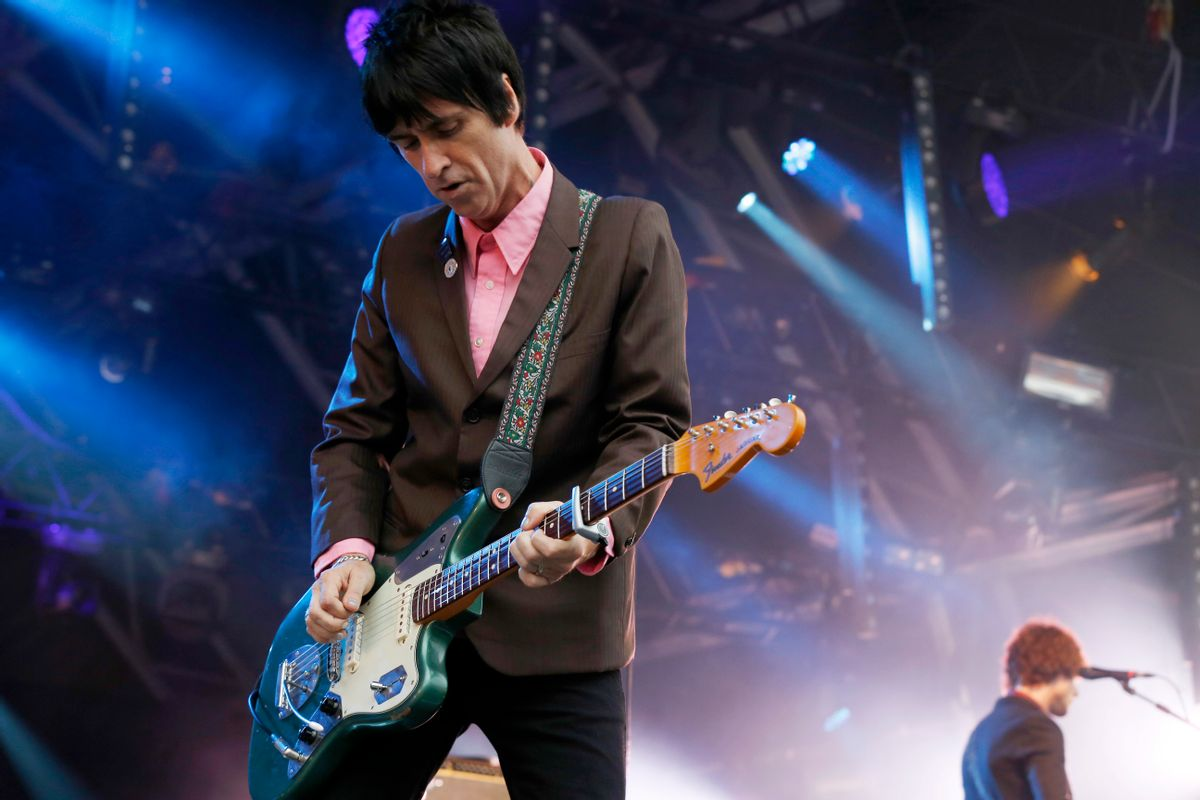 """FILE - In this Aug. 1, 2014 file photo, British singer Johnny Marr performs at Camp Bestival at Lulworth Castle in Dorset, England.The former guitarist for The Smiths has just released his second solo album, """"Playland,"""" a follow-up to well-received 2013 effort """"The Messenger."""" Both offer robust, richly textured guitar rock _ the latest of Marr's many musical modes.  (Photo by Jim Ross/Invision/AP, File) (Jim Ross/invision/ap)"""