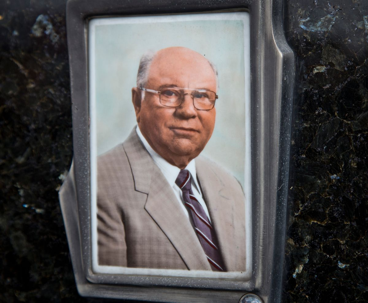 This July 28, 2014, photo shows Jakob Denzinger's portrait on the tombstone of his empty grave in Cepin eastern Croatia. Denzinger is among dozens of death camp guards and suspected Nazi war criminals who collected millions of dollars in Social Security payments despite being forced out of the United States according to an Associated Press investigation. (AP Photo/Darko Bandic) (AP)