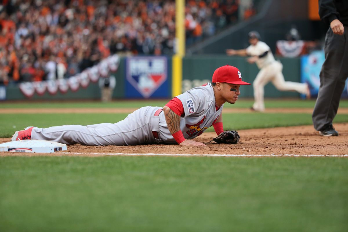 St. Louis Cardinals second baseman Kolten Wong lies by first base after he was unable to reach a wide throw by pitcher Randy Choate that allowed the game-winning San Francisco Giants run to score in the 10th inning of Game 3 of baseball's NL Championship Series, Tuesday, Oct. 14, 2014, in San Francisco. The Giants won 5-4 in 10 innings. (AP Photo/St. Louis Post-Dispatch, Chris Lee) (AP)