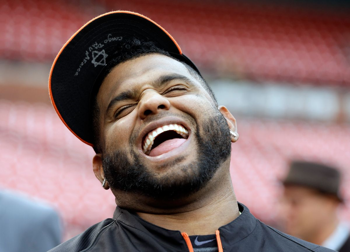 San Francisco Giants' Pablo Sandoval laughs during batting practice before Game 1 of the National League baseball championship series against the St. Louis Cardinals Saturday, Oct. 11, 2014, in St. Louis. (AP Photo/Jeff Roberson) (Jeff Roberson)