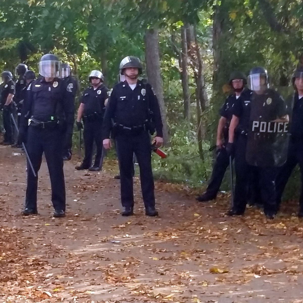 In this photo provided by Seth Meyer police officers line up. Local police, firefighters and ambulances in New Hampshire responded to large crowds of students as the annual Pumpkin Festival is underway near Keene State College Saturday, Oct. 18, 2014.  (AP/Seth Meyer)
