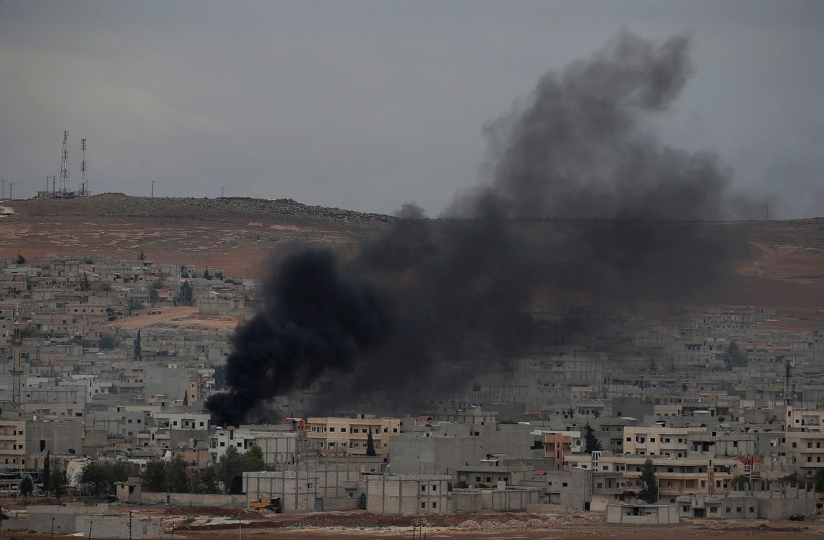 Smoke from a fire rises following a strike in Kobani, Syria, during fighting between Syrian Kurds and the militants of Islamic State group, as seen from a hilltop on the outskirts of Suruc, at the Turkey-Syria border, Sunday, Oct. 19, 2014. Kobani, also known as Ayn Arab, and its surrounding areas, has been under assault by extremists of the Islamic State group since mid-September and is being defended by Kurdish fighters. (AP Photo/Lefteris Pitarakis) (AP)