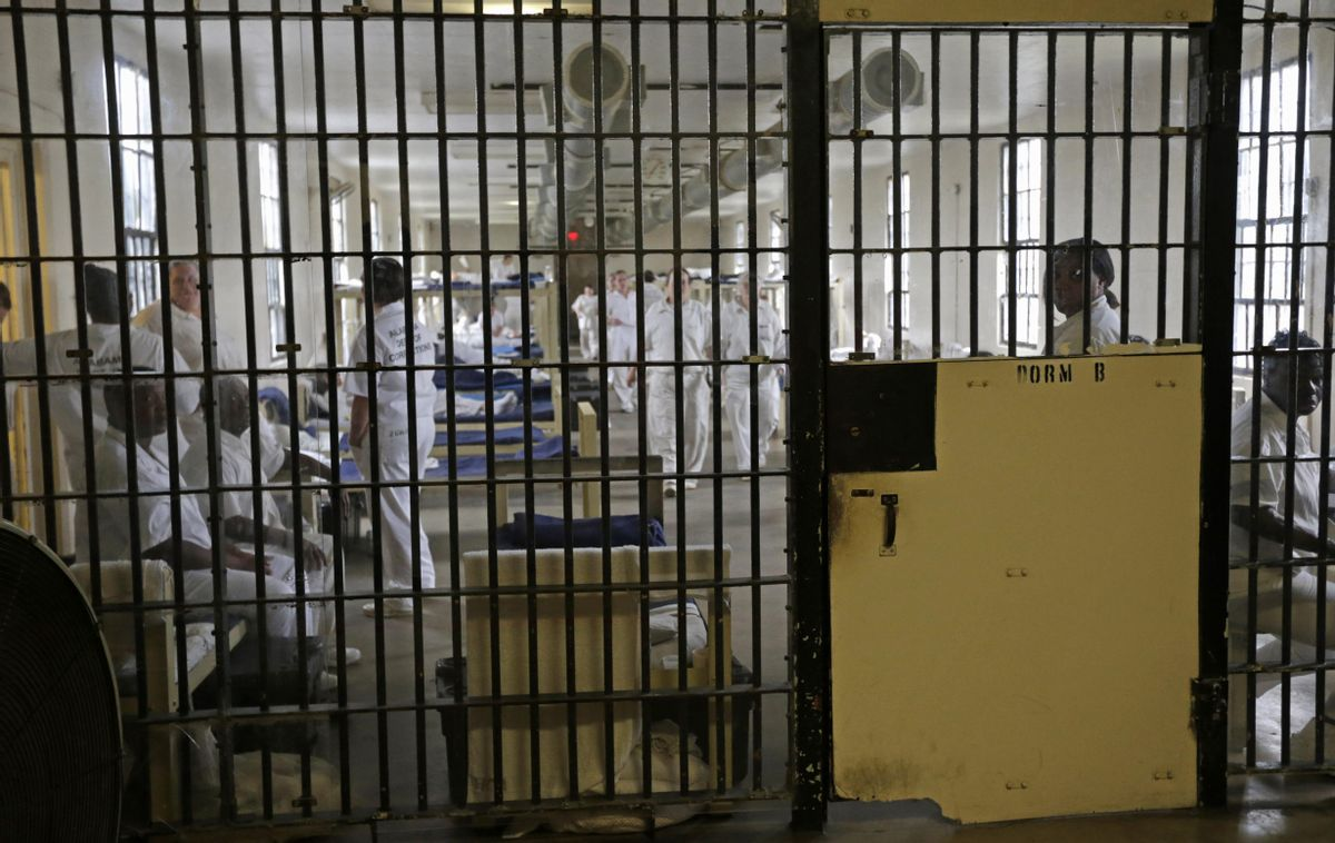 FILE - In this Sept. 23, 2013 file photo, inmates sit in their bunks in Dorm B at Tutwiler Prison for Women in Wetumpka, Ala. (AP Photo/Dave Martin, File) (AP)