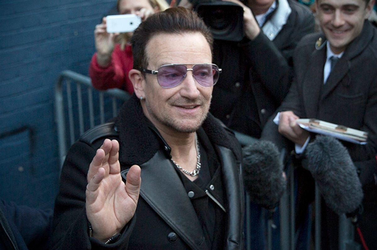 Bono leaves the recording of the Band Aid 30 charity single in west London,  November 15, 2014.         (Reuters/Neil Hall)