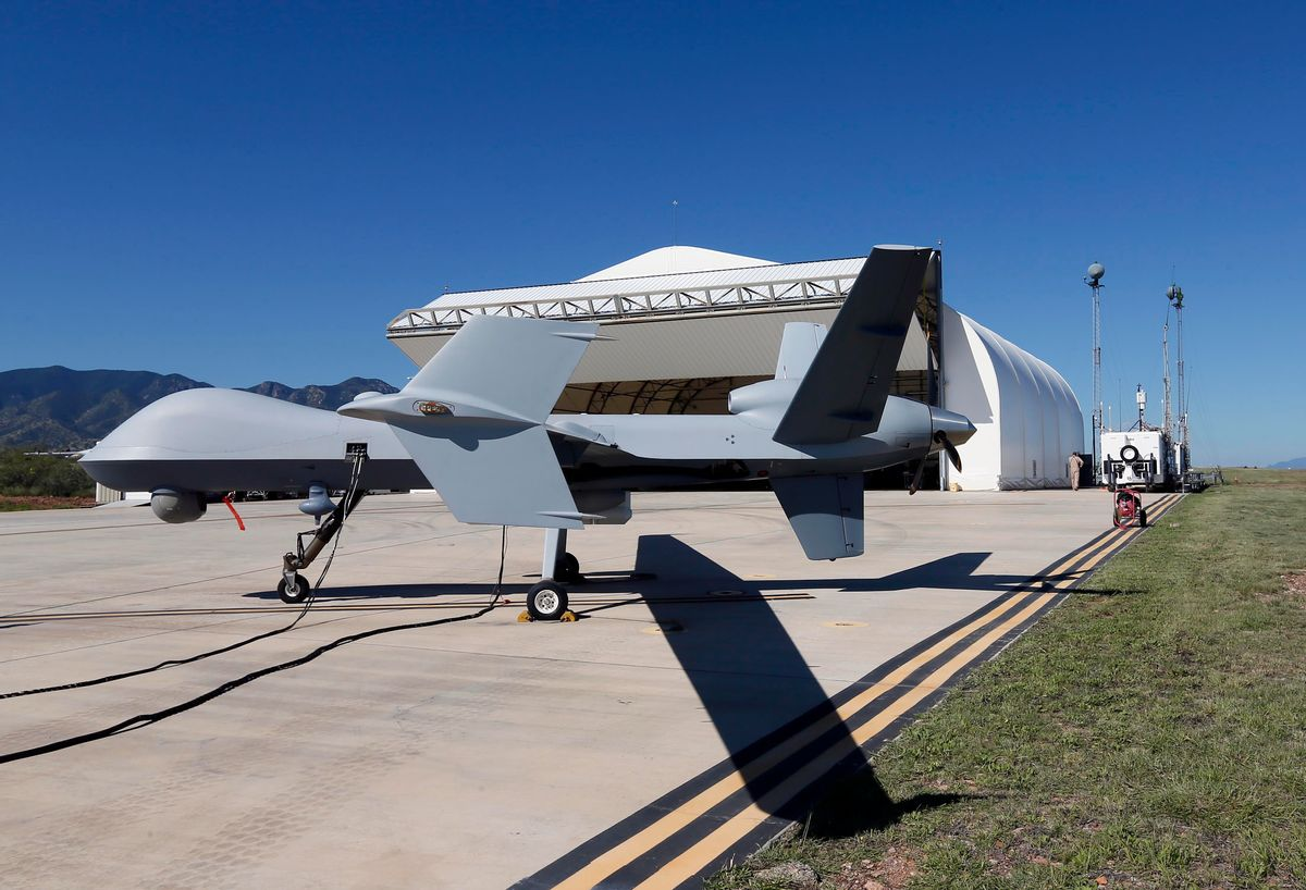 A U.S. Customs and Border Patrol drone aircraft is prepped prior to it's flight, Wednesday, Sept 24, 2014 at Ft. Huachuca in Sierra Vista, Ariz. The U.S. government now patrols nearly half the Mexican border by drones alone in a largely unheralded shift to control desolate stretches where there are no agents, camera towers, ground sensors or fences, and it plans to expand the strategy to the Canadian border. It represents a significant departure from a decades-old approach that emphasizes boots on the ground and fences. (AP Photo/Matt York) (AP)
