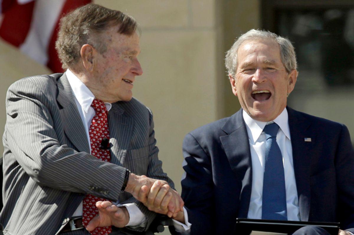 George H.W. Bush and George W. Bush during the dedication of the George W. Bush Presidential Center, April 25, 2013, in Dallas.           (AP/David J. Phillip)
