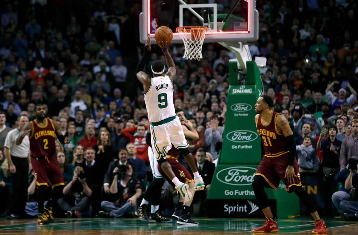 Boston Celtics guard Rajon Rondo (9) puts up a shot at the final buzzer, which he missed, during the second half of an NBA basketball game in Boston, Friday, Nov. 14, 2014. The Cavaliers edged out the Celtics 122-121. (AP Photo/Charles Krupa) (AP)
