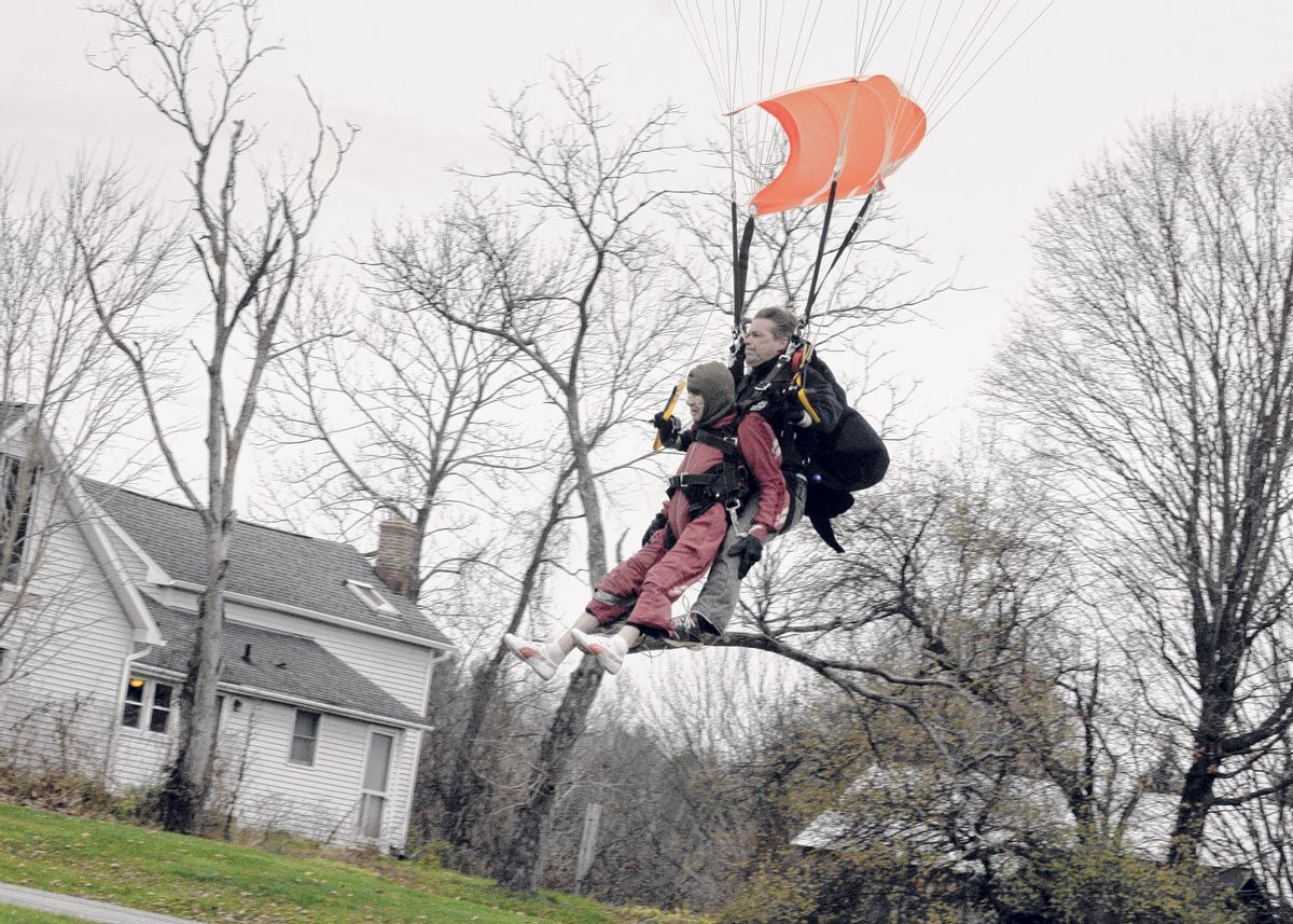 """In this Saturday, Nov. 8, 2014 photo, Eleanor """"Nanny"""" Cunningham, left, with tandem master Dean McDonald, come in for a landing after their skydive in Gansevoort, N.Y, a day after her 100th birthday. It was Cunningham's third jump, after taking up the sport at age 90. (AP Photo/The Albany Times Union, Michael P. Farrell)  TROY, SCHENECTADY; SARATOGA SPRINGS; ALBANY OUT (AP)"""