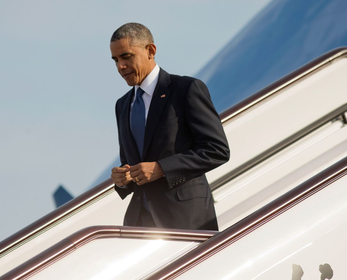 US President Barack Obama during his arrival on Air Force One at Beijing Capital International Airport, Monday, Nov. 10, 2014 in Beijing, China. Obama is in China to attend the Asia-Pacific Economic Cooperation (APEC) Summit. (AP Photo/Pablo Martinez Monsivais) (Pablo Martinez Monsivais)