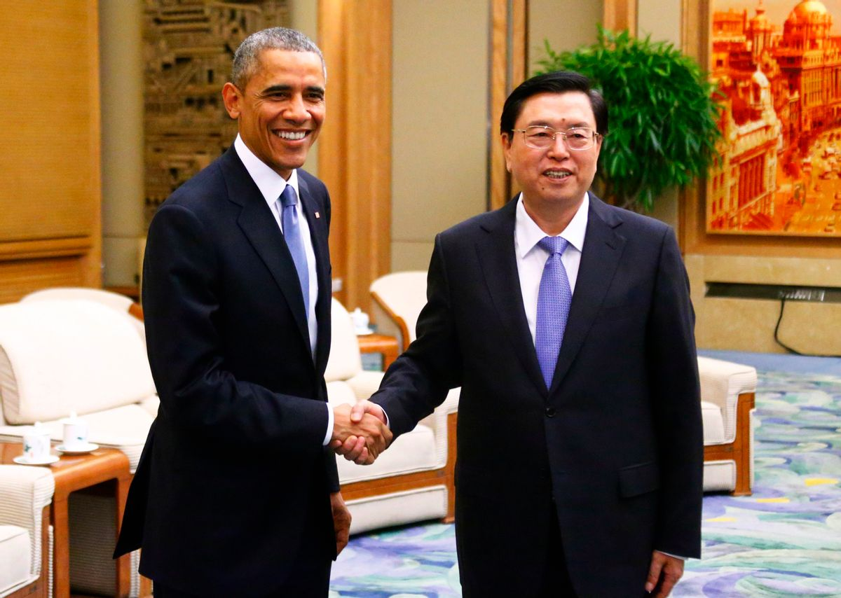U.S. President Barack Obama (L) shakes hands with Chairman of the Standing Committee of the National People's Congress (NPC) Zhang Dejiang during a meeting at the Great Hall of the People, in Beijing, November 12, 2014. REUTERS/Petar Kujundzic (CHINA)