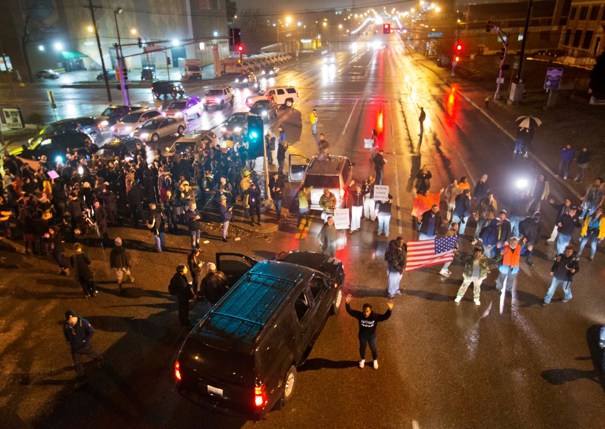 Demonstrators block a busy intersection while marching through the streets to protest the August shooting of Michael Brown, Sunday, Nov. 23, 2014, in St. Louis. Ferguson and the St. Louis region are on edge in anticipation of the announcement by a grand jury whether to criminally charge officer Darren Wilson in the killing of 18-year-old Brown. (AP Photo/David Goldman) (AP)