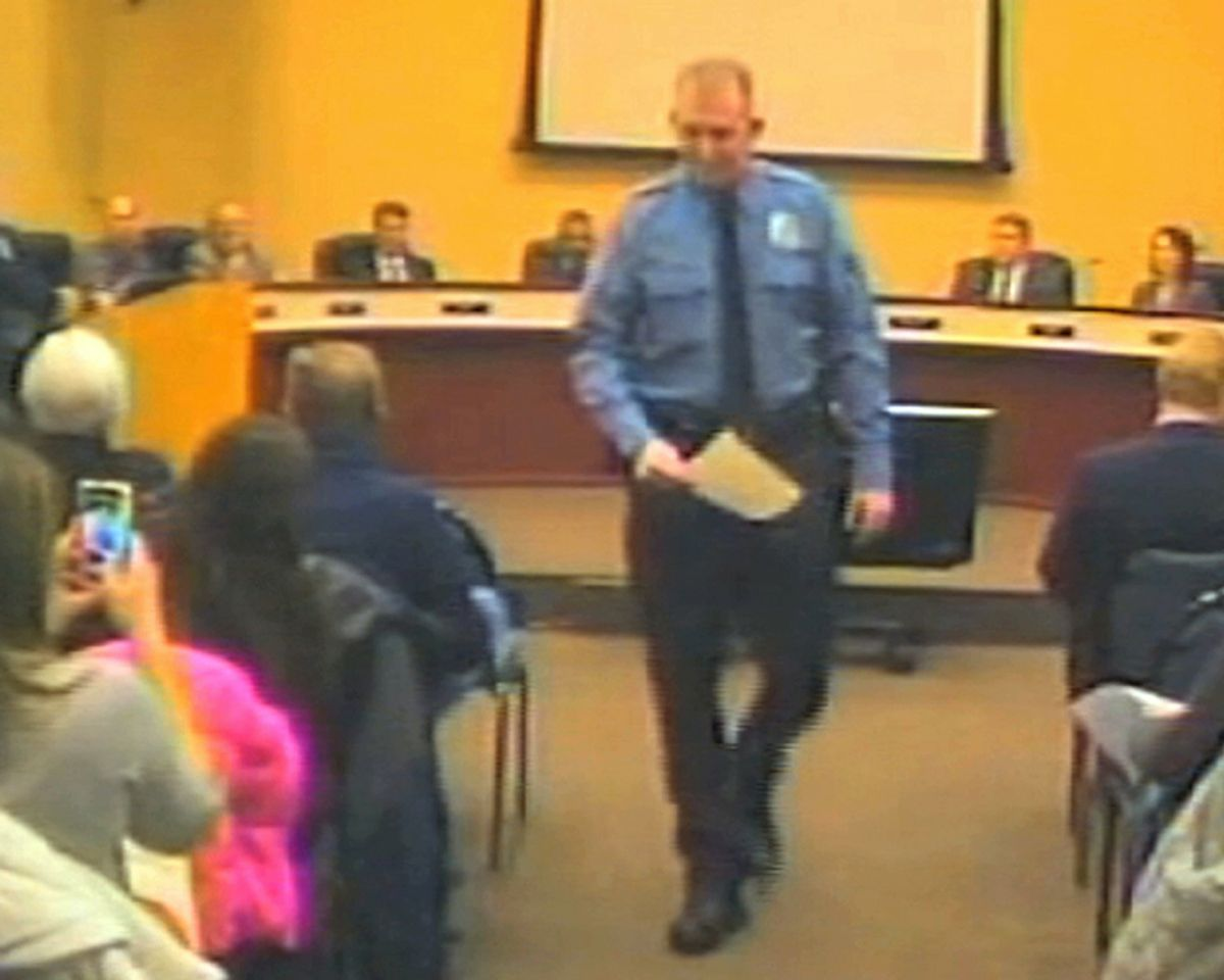 FILE - In this file Feb. 11, 2014 image from video released by the City of Ferguson, Mo., is officer Darren Wilson at a city council meeting in Ferguson. A  grand jury said Monday, Nov. 24, 2014 that it has reached a decision about whether to indict Wilsoin in the shooting death of Michael Brown, according to a lawyer for Brown's family. (AP Photo/City of Ferguson) (AP)