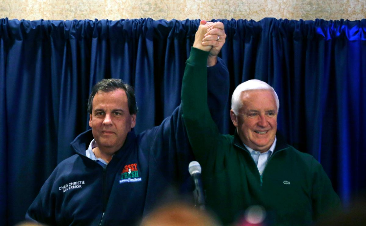 Pennsylvania Gov. Tom Corbett, right, and New Jersey Gov. Chris Christie raises the arms at a gathering at a campaign rally Sunday, Nov. 2, 2014, in Ivyland, Pa. Corbett will face Democratic challenger Tom Wolf in Tuesday's election. (AP Photo/Mel Evans) (AP)