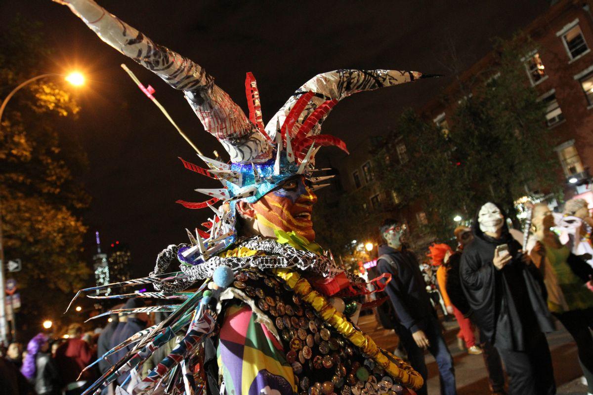 Dressed as Mr. Halloween, Rolanda Vega takes part in the Village Halloween Parade in New York Friday Oct. 31, 2014. (AP Photo/Tina Fineberg) (AP)