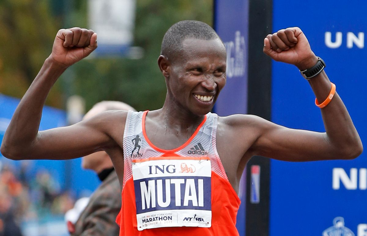 FILE - Geoffrey Mutai of Kenya celebrates his first place win in the men's division of the New York City Marathon, in this Nov. 3, 2013 file photo taken in New York. He seeks to become the first man to win three straight NYC Marathon titles since Alberto Salazar from 1980-82. (AP Photo/Kathy Willens, File) (AP)