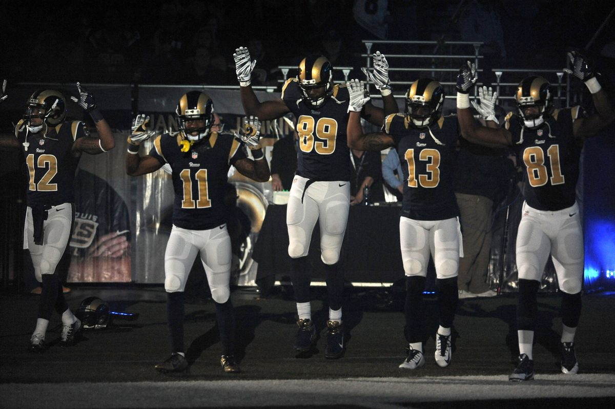 Members of the St. Louis Rams raise their arms as they walk onto the field during introductions before an NFL football game against the Oakland Raiders, Sunday, Nov. 30, 2014, in St. Louis. (AP Photo/L.G. Patterson)    (AP)