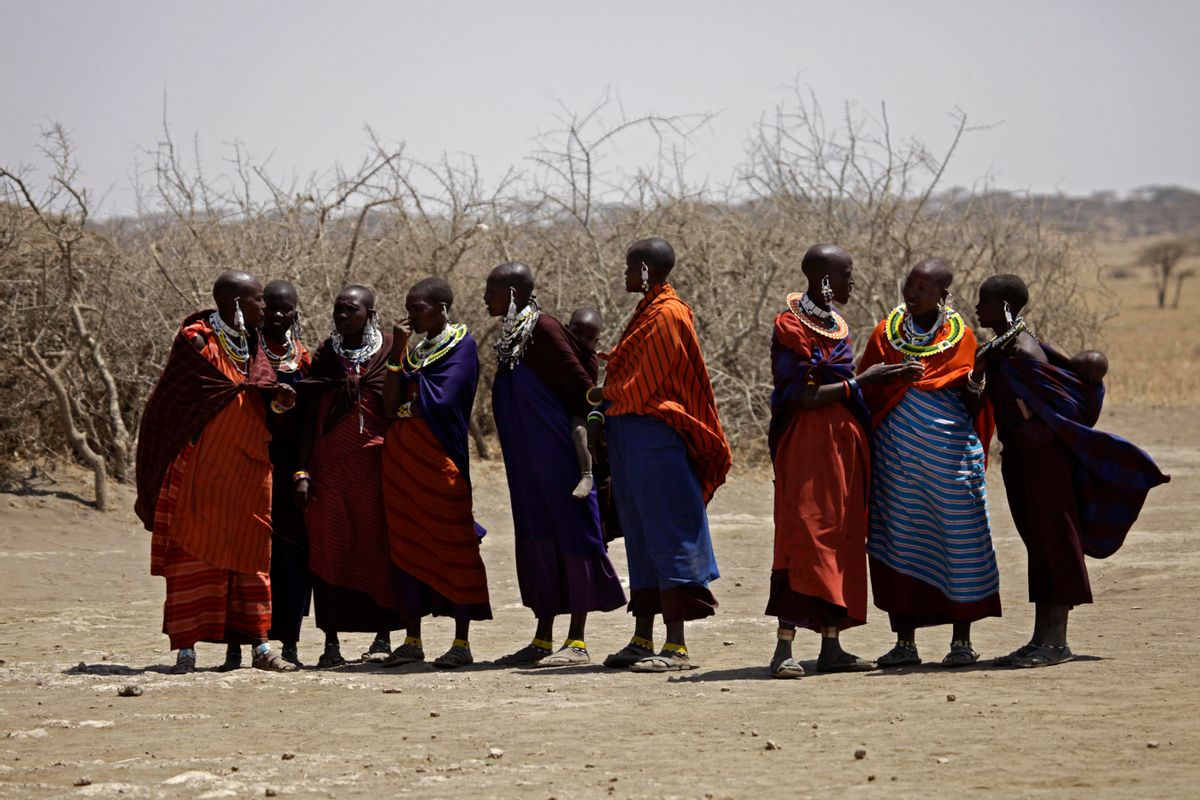 FILE - In this Monday, Aug. 12, 2013 file photo, Maasai tribeswomen gather at a village on the outskirts of the Serengeti, in northern Tanzania.  (AP/Nariman El-Mofty)