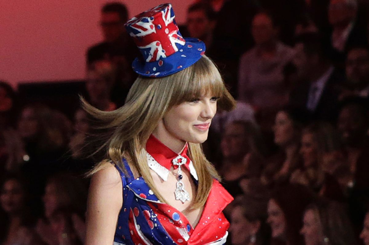 Taylor Swift performs during the annual Victoria's Secret Fashion Show in New York, November 13, 2013.                 (Reuters/Lucas Jackson)