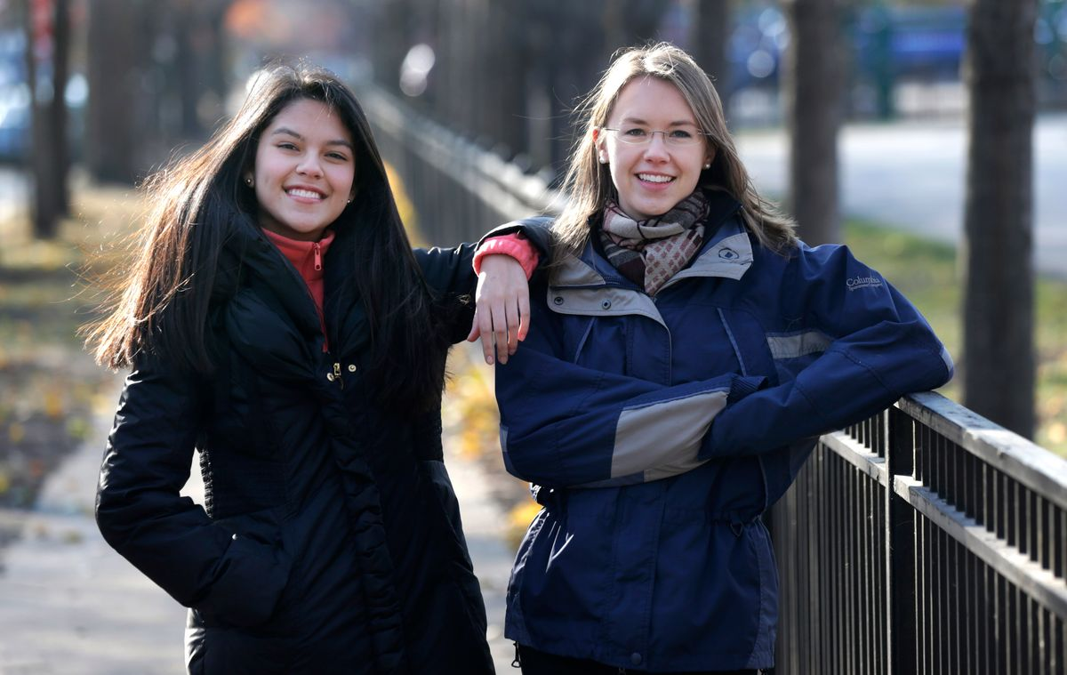 In this Nov. 19, 2014 photo, Lakeview High School teacher Kristin Hu, right, who attends the LaSalle Street Church, poses for a portrait with student Lucy, outside the school in Chicago. In September, members and regulars at the church each received $500 checks from the church. Hu plans to give $500 to a Dreamer organization or start a scholarship foundation for the kids. Lucy, a Mexican-born Dreamer in her class, inspired Hu after she spoke of how she and others want to attend college but don't qualify for financial aid because of their immigration status. (AP Photo/Charles Rex Arbogast) (AP)