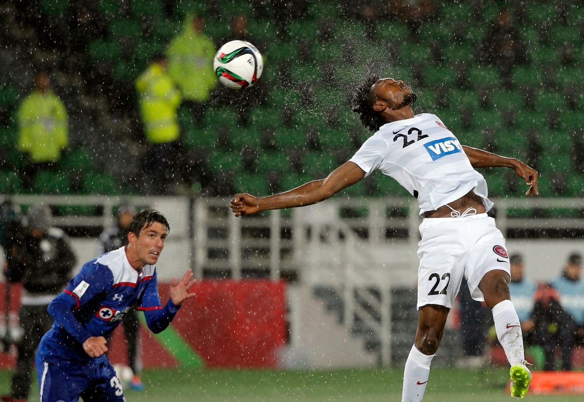10ThingstoSeeSports - Western Sydney Wanderers' Seyi Adeleke, right, jumps to head the ball as Cruz Azul's Mauro Formica looks on during their soccer match at the Club World Cup soccer tournament in Rabat, Morocco, Saturday, Dec. 13, 2014. (AP Photo/Christophe Ena, File) (AP)