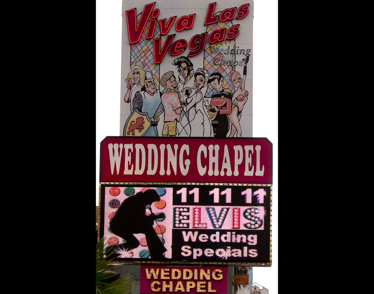 FILE - The Viva Las Vegas Wedding Chapel marquee advertises wedding specials on in this Nov. 11, 2011 file photo taken in Las Vegas. The Viva Las Vegas wedding chapel plans to marry 120 couples Saturday Dec. 13, 2014 starting with Egyptian-themed nuptials followed by weddings with a touch of Tom Jones, gangsters, Liberace and, of course, Elvis, said general manager Brian Mills. (AP Photo/Julie Jacobson, File) (AP)