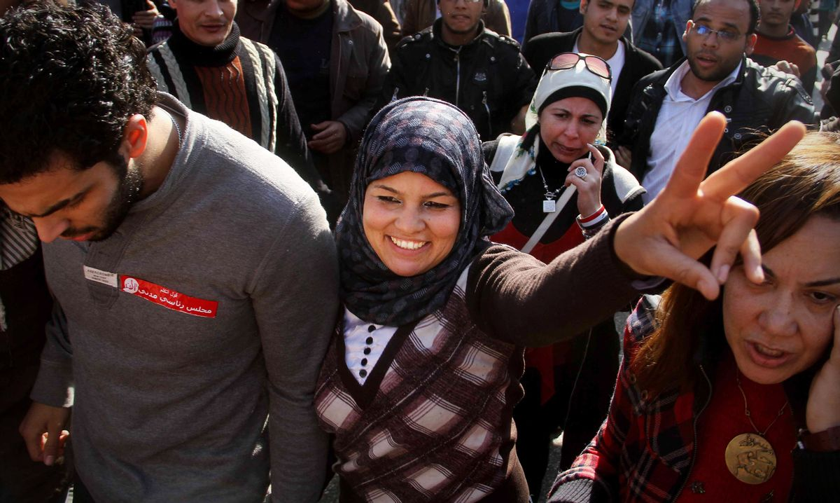 Samira Ibrahim, an Egyptian activist and virginity testing opponent, at a women's rights protest in Cairo   (Associated Press)