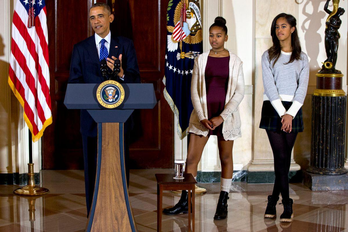 President Barack Obama with his daughters, Sasha and Malia                (Associated Press)