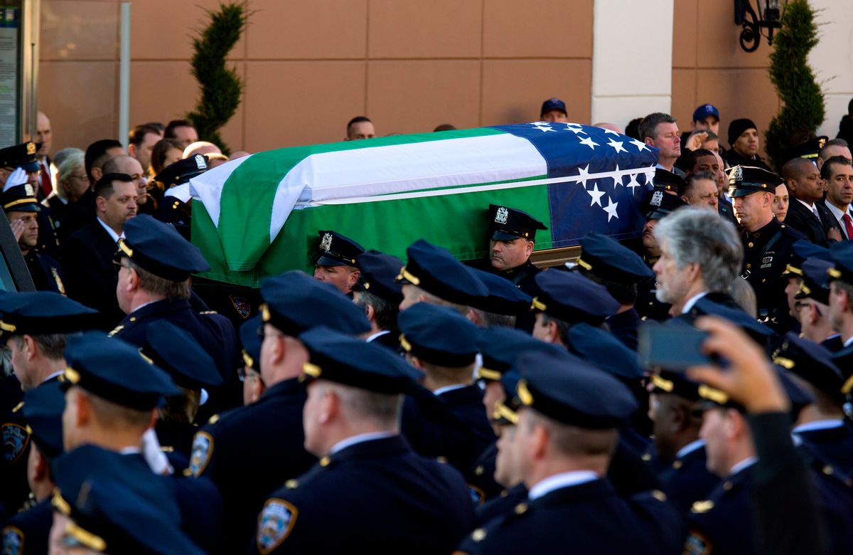 ADDS FLAG IS THAT OF THE NYPD - The body of New York City police officer Rafael Ramos is brought from Christ Tabernacle Church draped in an NYPD flag after his funeral in the Glendale section of Queens, where he was a church member, Saturday, Dec. 27, 2014, in New York. Ramos and his partner, officer Wenjian Liu, were killed Dec. 20 as they sat in their patrol car on a Brooklyn street. The shooter, Ismaaiyl Brinsley, later killed himself. (AP Photo/Craig Ruttle) (AP)