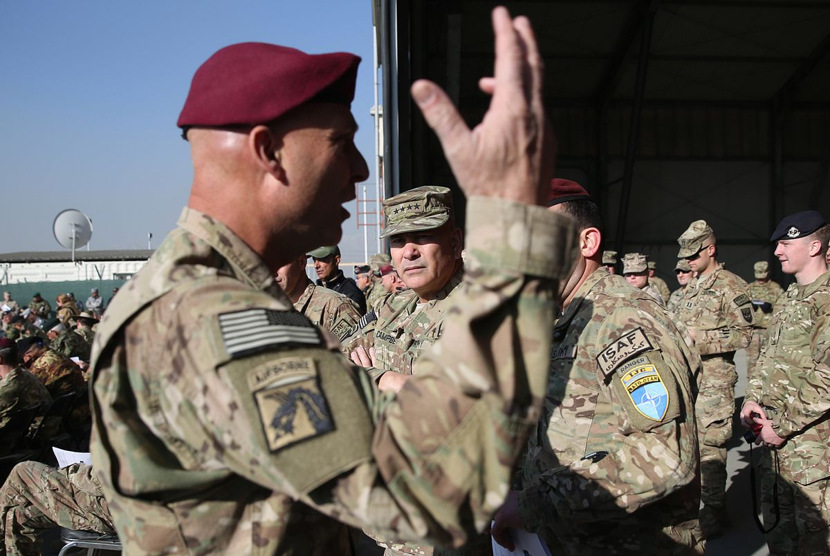 Commander of International Security Assistance Force, General John F. Campbell, center, takes part in a flag-lowering ceremony in Kabul International Airport in Kabul, Afghanistan, Monday, Dec. 8, 2014. The U.S. and NATO ceremonially ended their combat mission in Afghanistan on Monday, 13 years after the Sept. 11 terror attacks sparked their invasion of the country to topple the Taliban-led government. (AP Photo/Massoud Hossaini) (AP)