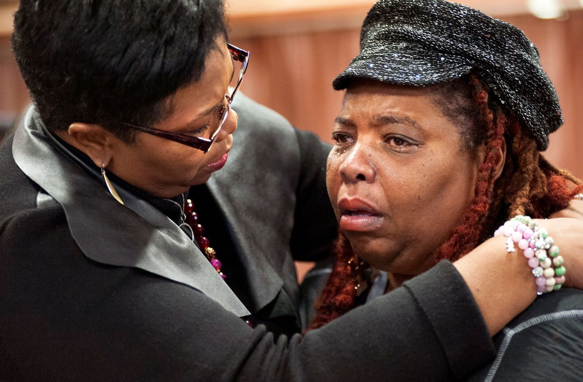 Dell Taylor, right, is comforted by the Rev.Traci Blackmon, a member of the Ferguson Commission appointed by Missouri Gov. Jay Nixon, during the opening meeting of the commission at the Ferguson Community Center in Ferguson, Mo. Monday, Dec. 1, 2014.  The 16-person panel was chosen by Missouri's governor to help find long-term solutions after the Ferguson police shooting of an unarmed man. (AP Photo/Sid Hastings) (AP)