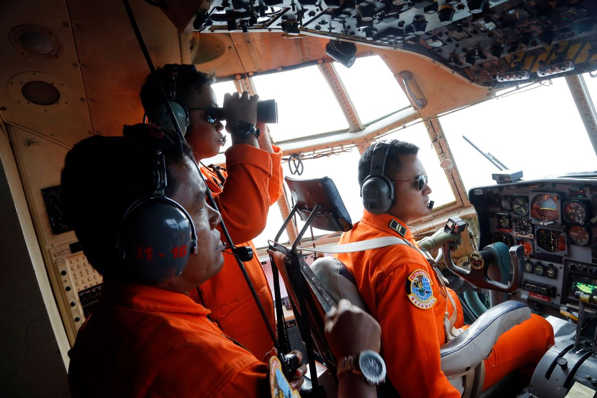Crew of Indonesian Air Force C-130 airplane of the 31st Air Squadron scan the horizon during a search operation for the missing AirAsia flight 8501 jetliner over the waters of Karimata Strait in Indonesia, Monday, Dec. 29, 2014. Search planes and ships from several countries on Monday were scouring Indonesian waters over which an AirAsia jet disappeared, more than a day into the region's latest aviation mystery. AirAsia Flight 8501 vanished Sunday in airspace thick with storm clouds on its way from Surabaya, Indonesia, to Singapore. (AP Photo/Dita Alangkara) (Dita Alangkara)