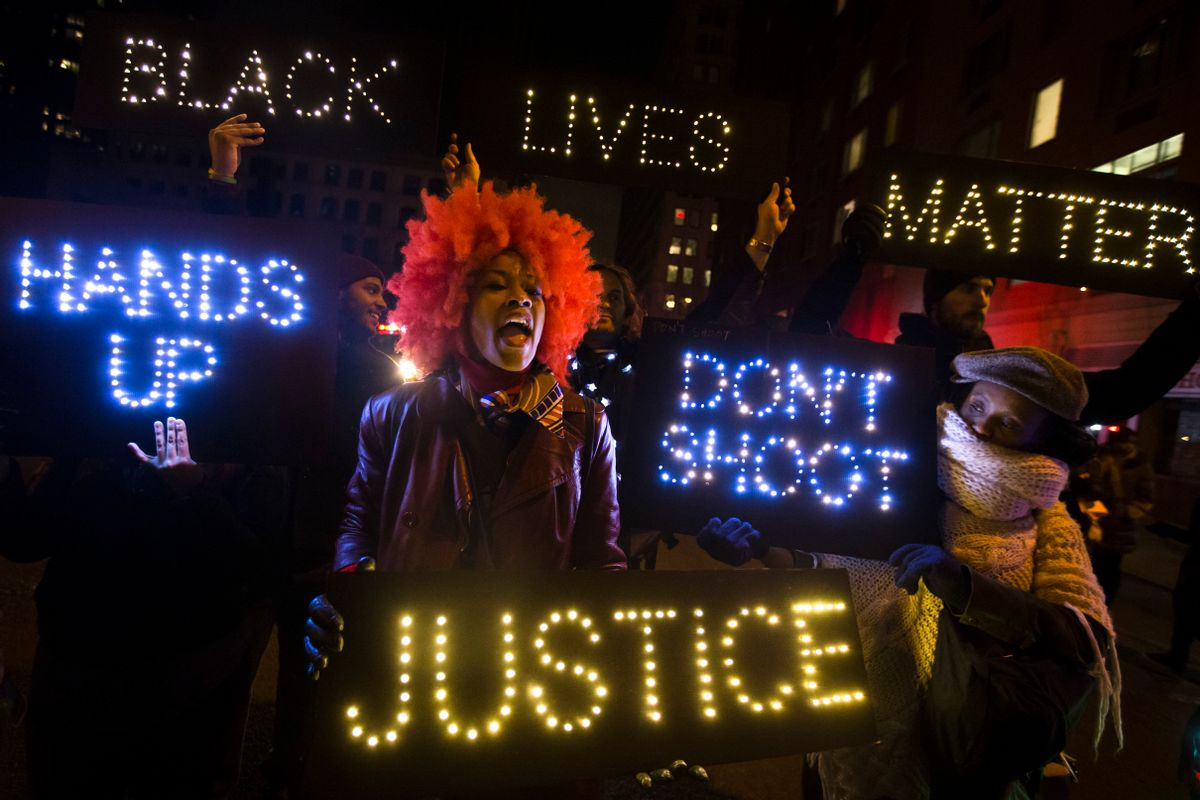 A demonstrator chants during a rally in downtown Manhattan in New York, Saturday, Dec. 13, 2014, during the Justice for All rally and march. In the past three weeks, grand juries have decided not to indict officers in the chokehold death of Eric Garner in New York and the fatal shooting of Michael Brown in Ferguson, Mo. The decisions have unleashed demonstrations and questions about police conduct and whether local prosecutors are the best choice for investigating police. (AP Photo/John Minchillo) (AP)