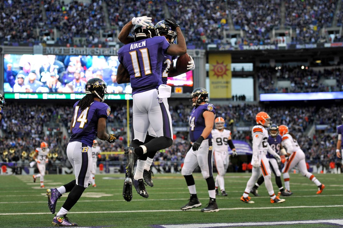 Baltimore Ravens wide receiver Kamar Aiken (11) celebrates his touchdown with teammate Torrey Smith in the second half of an NFL football game against the Cleveland Browns, Sunday, Dec. 28, 2014, in Baltimore. Baltimore won 20-10. (AP Photo/Gail Burton) (AP)