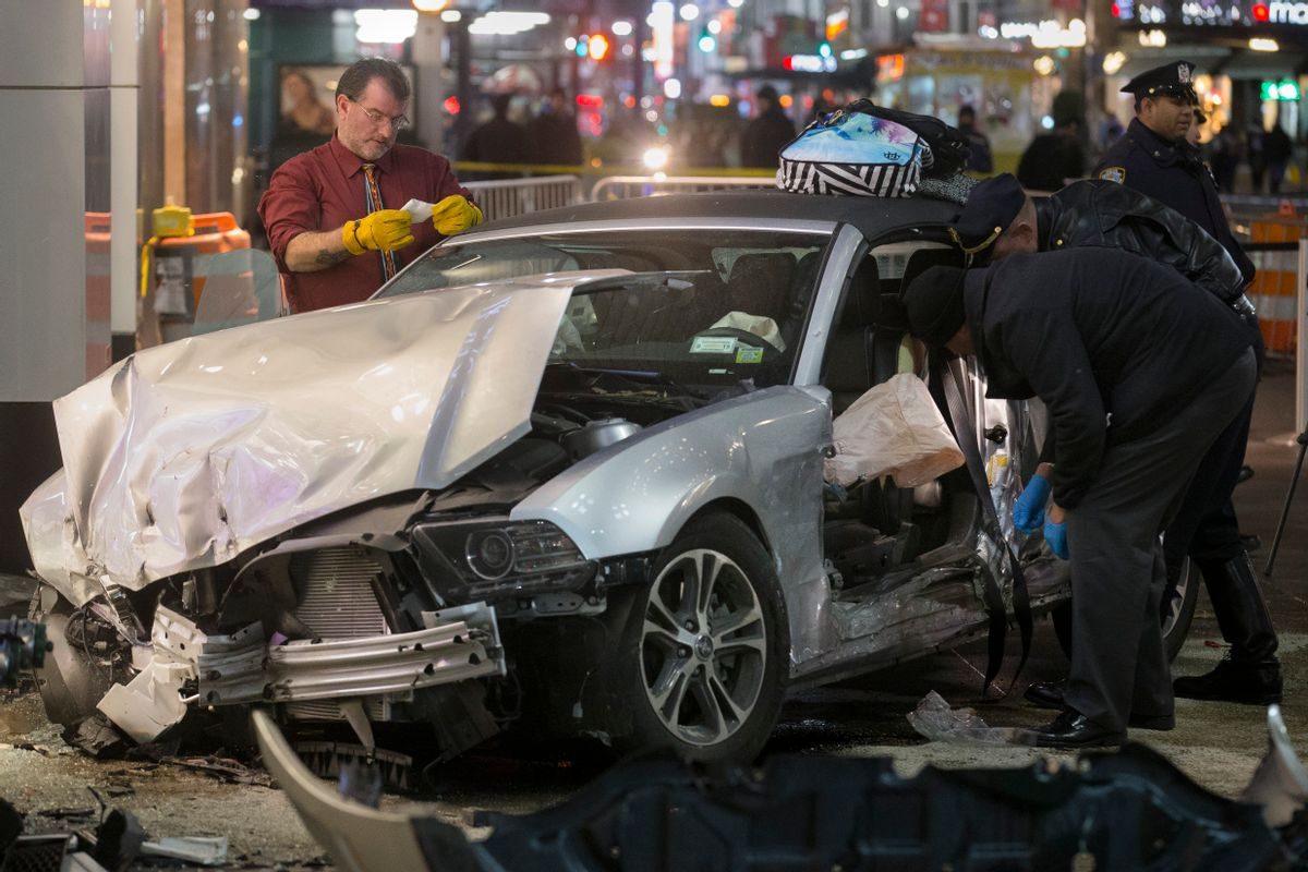 Police search a car at the scene of a vehicular accident on 34th Street, Thursday, Dec. 11, 2014, in New York. Six people were hurt when the car jumped a curb in midtown Manhattan and struck a group of people around 10 p.m. A fire department spokesman says the injured were taken to Bellevue hospital with serious but non-life threatening injuries. (AP Photo/John Minchillo) (AP)