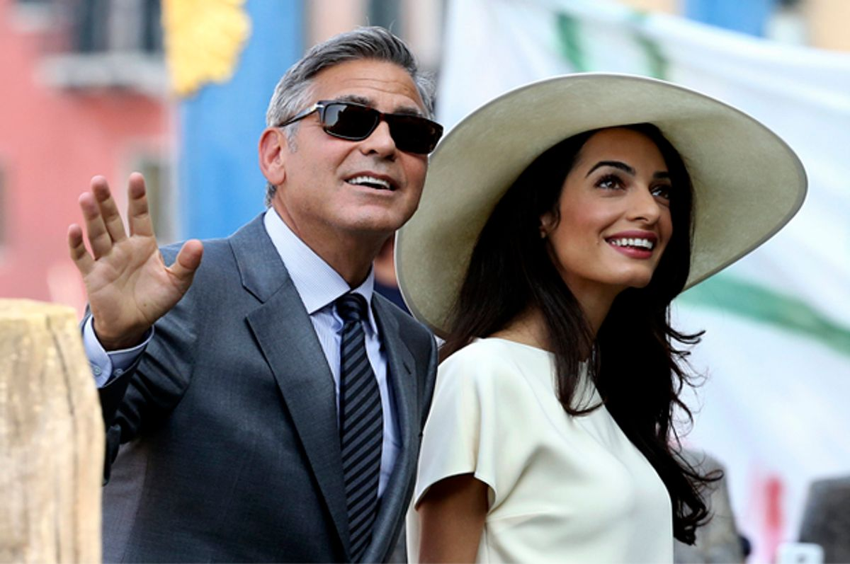 Amal and George Clooney         (Reuters/Alessandro Bianchi)