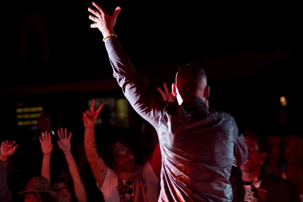 In this Nov. 30, 2014, photo, Cuban fans sing during a hip-hop concert in Havana. Documents obtained by The Associated Press show that a U.S. agency infiltrated Cuba's hip-hop scene, recruiting unwitting rappers to spark a youth movement against the government. (AP Photo/Ramon Espinosa) (AP)