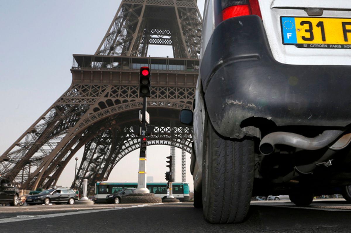 A car drives near the Eiffel tower in Paris, March 14, 2014.             (Reuters/Charles Platiau)