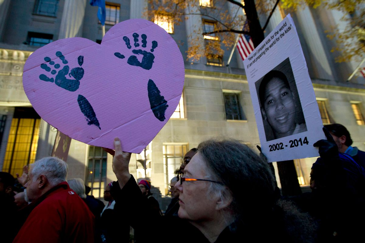 Demonstrators protest against the shooting death of unarmed 18-year-old Michael Brown at the Department of Justice in Washington, Monday, Dec. 1, 2014. A grand jury in Ferguson, Mo., on Monday, Nov. 24, 2014, declined to indict police officer Darren Wilson in the shooting death of Brown, an unarmed black man. Protesters across the U.S. have walked off their jobs or away from classes in support of the Ferguson protesters. Monday's walkouts stretched from New York to San Francisco, and included Chicago and Washington, D.C.  (AP Photo/Jose Luis Magana) (AP)