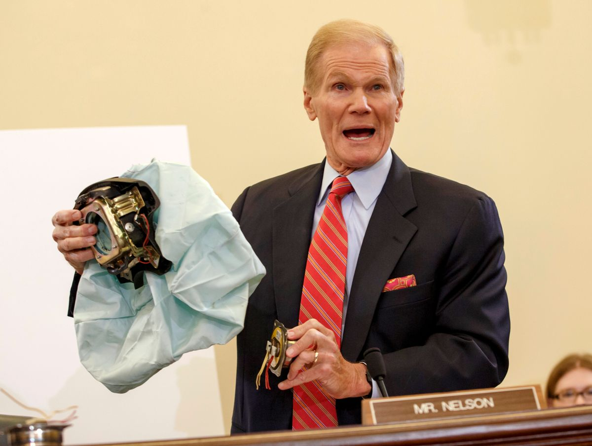FILE - In this Nov. 20, 2014 file photo, U.S. Senate Commerce Committee member Sen. Bill Nelson, D-Fla. displays the parts and function of a defective airbag made by Takata of Japan that has been linked to multiple deaths and injuries in cars driven in the U.S., during the committee's hearing on Capitol Hill in Washington. Automakers issued more than 700 recalls in the U.S. alone this year, covering 55 million cars and trucks. (AP Photo/J. Scott Applewhite, File) (AP)