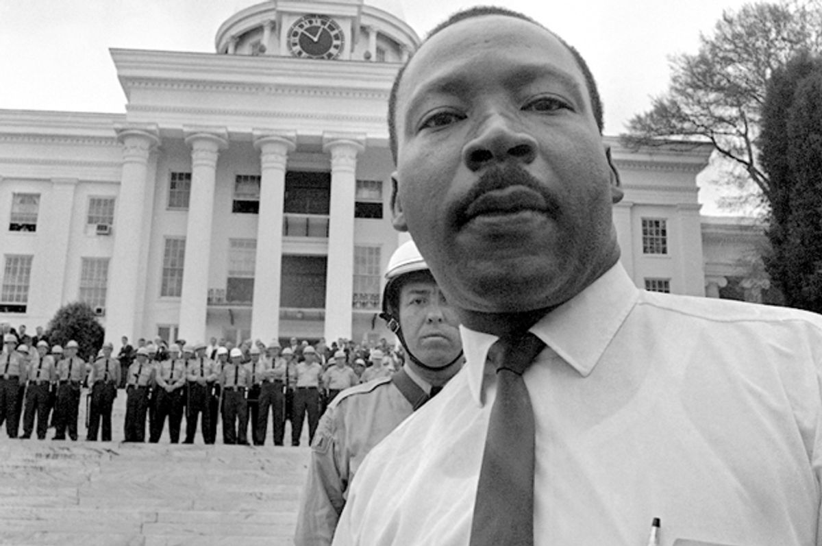 State troopers stand shoulder to shoulder on the steps of Alabama's State Capitol on March 25, 1965, barring Dr. Martin Luther King, Jr. from entering.       (AP)