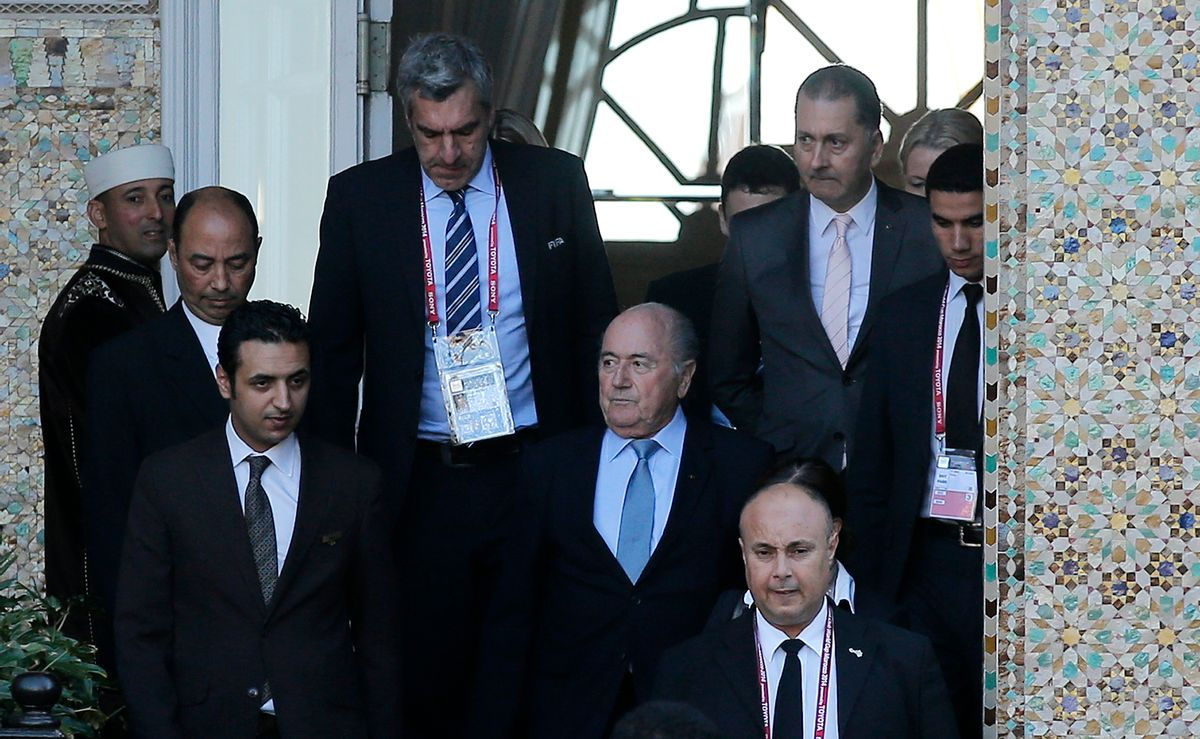 FIFA president Sepp Blatter, center, leaves a hotel to lead a meeting in Marrakech, Morocco, Thursday, Dec. 18, 2014. Amid another crisis at FIFA, Blatter will lead an executive committee meeting on Thursday with the sudden resignation of ethics prosecutor Michael Garcia now on the agenda. (AP Photo/Christophe Ena) (AP)