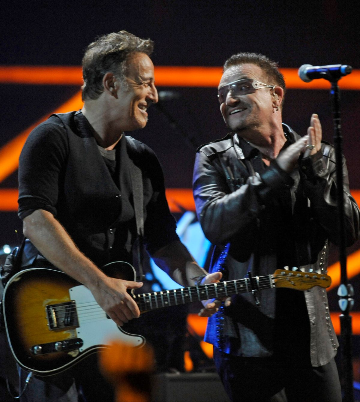 """FILE - In this Oct. 30, 2009 file photo, Bono, right, and Bruce Springsteen perform at the 25th Anniversary Rock & Roll Hall of Fame concert at Madison Square Garden, in New York. Springsteen and Coldplay's Chris Martin will act as Bono at a concert Monday night, Dec. 1, 2014, in New York City. U2 announced on its website that the singers will perform at Duffy Square in Times Square alongside Kanye West and Carrie Underwood for """"U2 Minus 1 _ Live in New York Tonight."""" (AP Photo/Henny Ray Abrams, File)  (AP)"""
