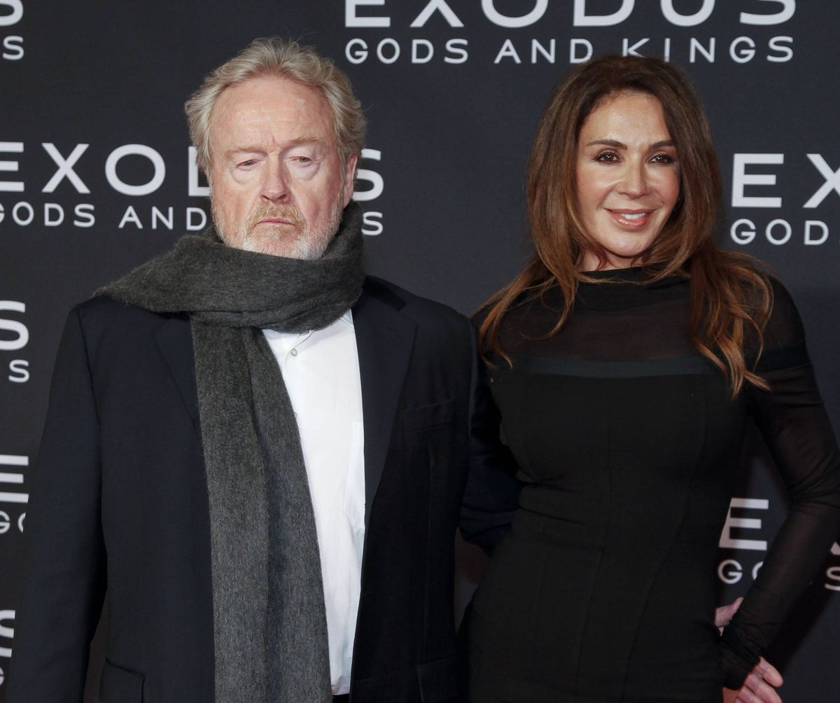 """Ridley Scott, left, and Giannina Facio, right, attend the premiere of """"Exodus: Gods and Kings"""" at The Brooklyn Museum on Sunday, Dec. 7, 2014, in New York. (Andy Kropa/Invision/AP)"""