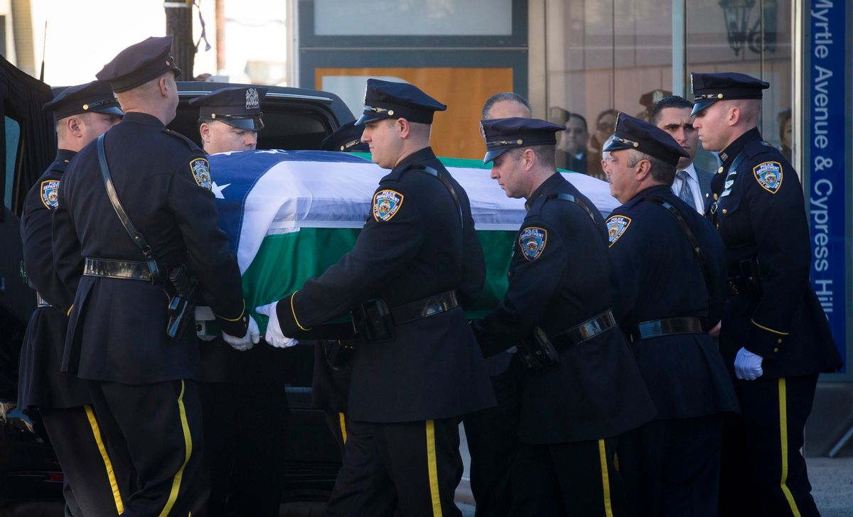 New York City police officers carry the casket of New York Police Department officer Rafael Ramos at his wake at Christ Tabernacle Church, in the Glendale section of Queens, where he was a member, Friday, Dec. 26, 2014, in New York.  Ramos was killed Dec. 20 along with his partner, Officer Wenjian Liu, as they sat in their patrol car in Brooklyn. The shooter, Ismaaiyl Brinsley, later killed himself. (AP Photo/John Minchillo) (AP)