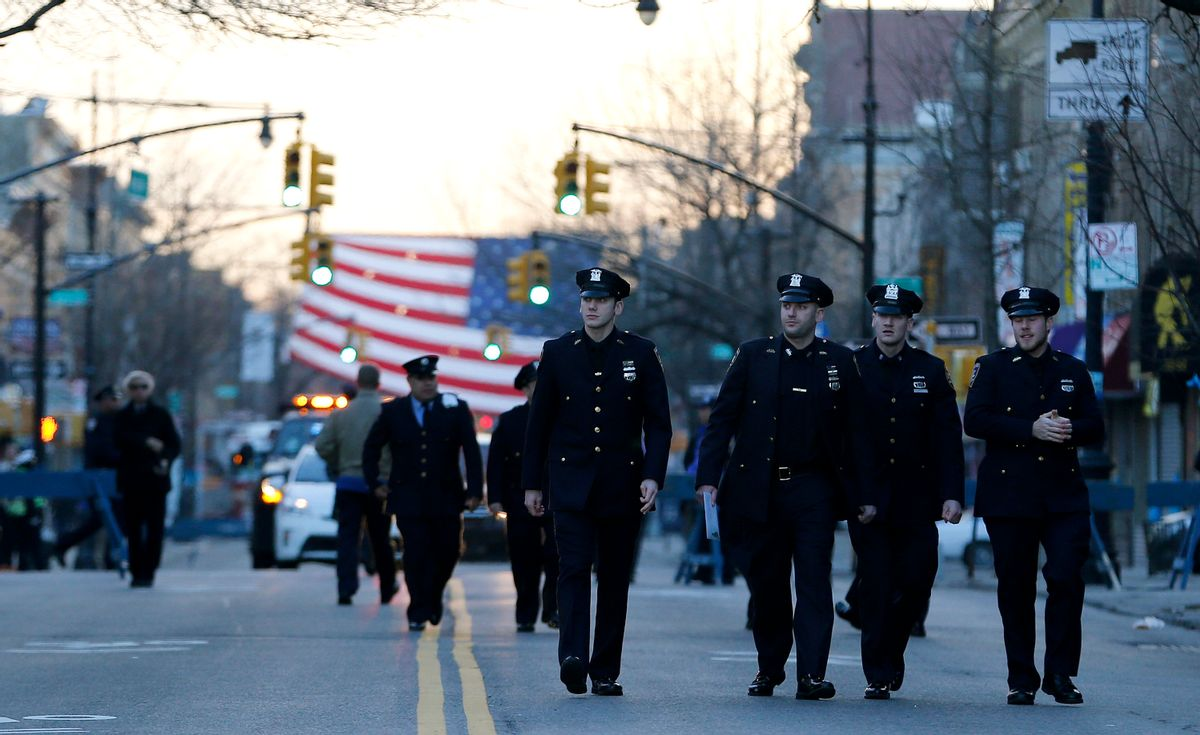 New York City police officers walk toward Christ Tabernacle Church before funeral services for officer Rafael Ramos at in the Glendale section of Queens, Saturday, Dec. 27, 2014, in New York. Ramos and his partner, officer Wenjian Liu, were killed Dec. 20 as they sat in their patrol car on a Brooklyn street. The shooter, Ismaaiyl Brinsley, later killed himself. (AP Photo/Julio Cortez) (AP)