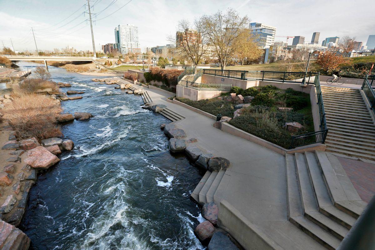 In this Monday, Dec. 8, 2014 photo, water flows past a sculpted landscape at Confluence Park, where Cherry Creek joins the South Platte, a key channel in Colorado's water supply, in Denver. (AP Photo/Brennan Linsley) (AP)