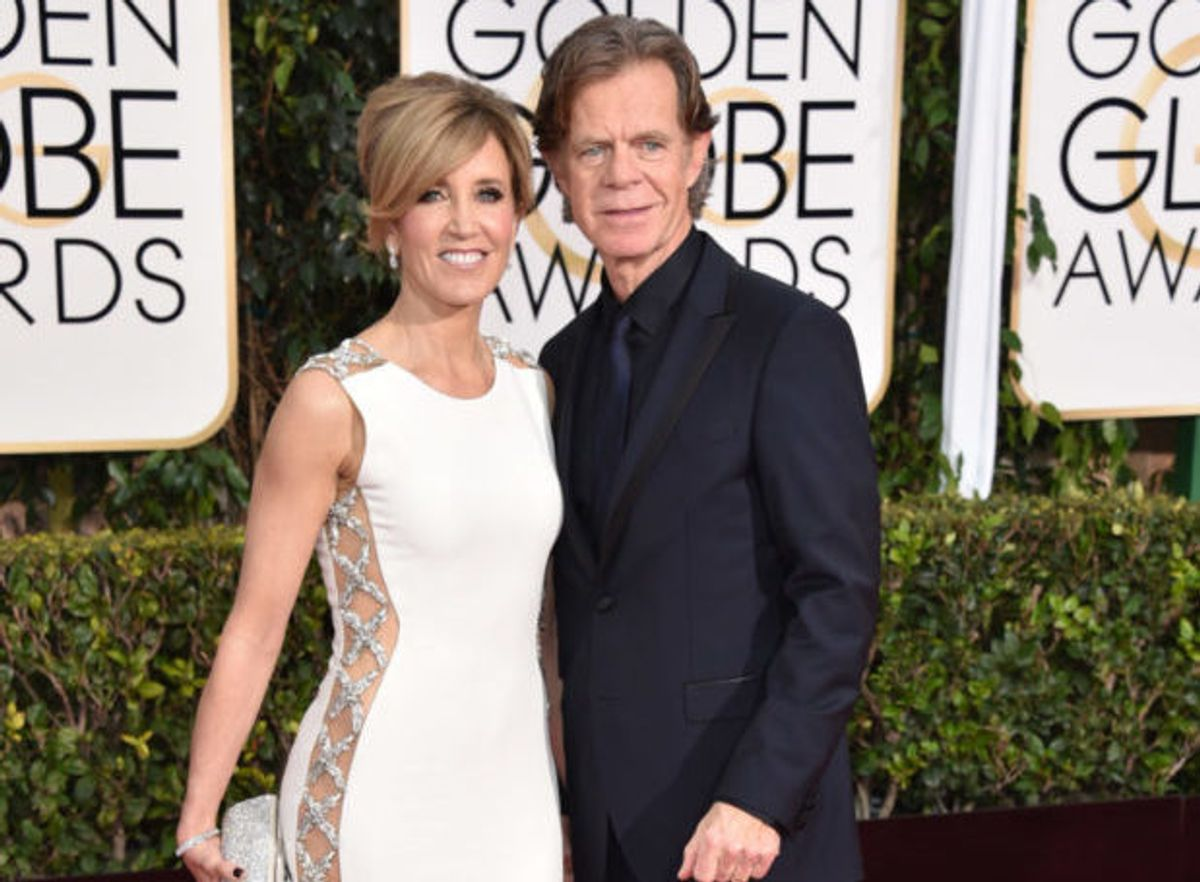 Felicity Huffman, left, and William H. Macy arrive at the 72nd annual Golden Globe Awards at the Beverly Hilton Hotel on Sunday, Jan. 11, 2015, in Beverly Hills, Calif. (Photo by John Shearer/Invision/AP) (John Shearer/invision/ap)