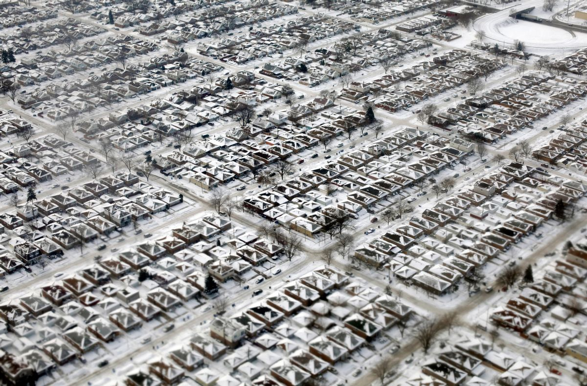 FILE- This Jan. 8, 2014, file photo shows homes covered in snow and ice in Chicago. (AP Photo/Kiichiro Sato, File) (AP)