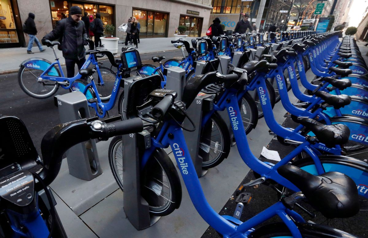 Citbike cyclists pick up their rides near Grand Central Terminal, in New York, Tuesday, Jan. 13, 2015. Now that it has moved from laid-back Portland, Oregon, to amped-up New York, the company that runs bike-sharing programs in New York, Chicago and other major cities is changing its name from Alta Bicycle Share to Motivate. (AP Photo/Richard Drew) (AP)