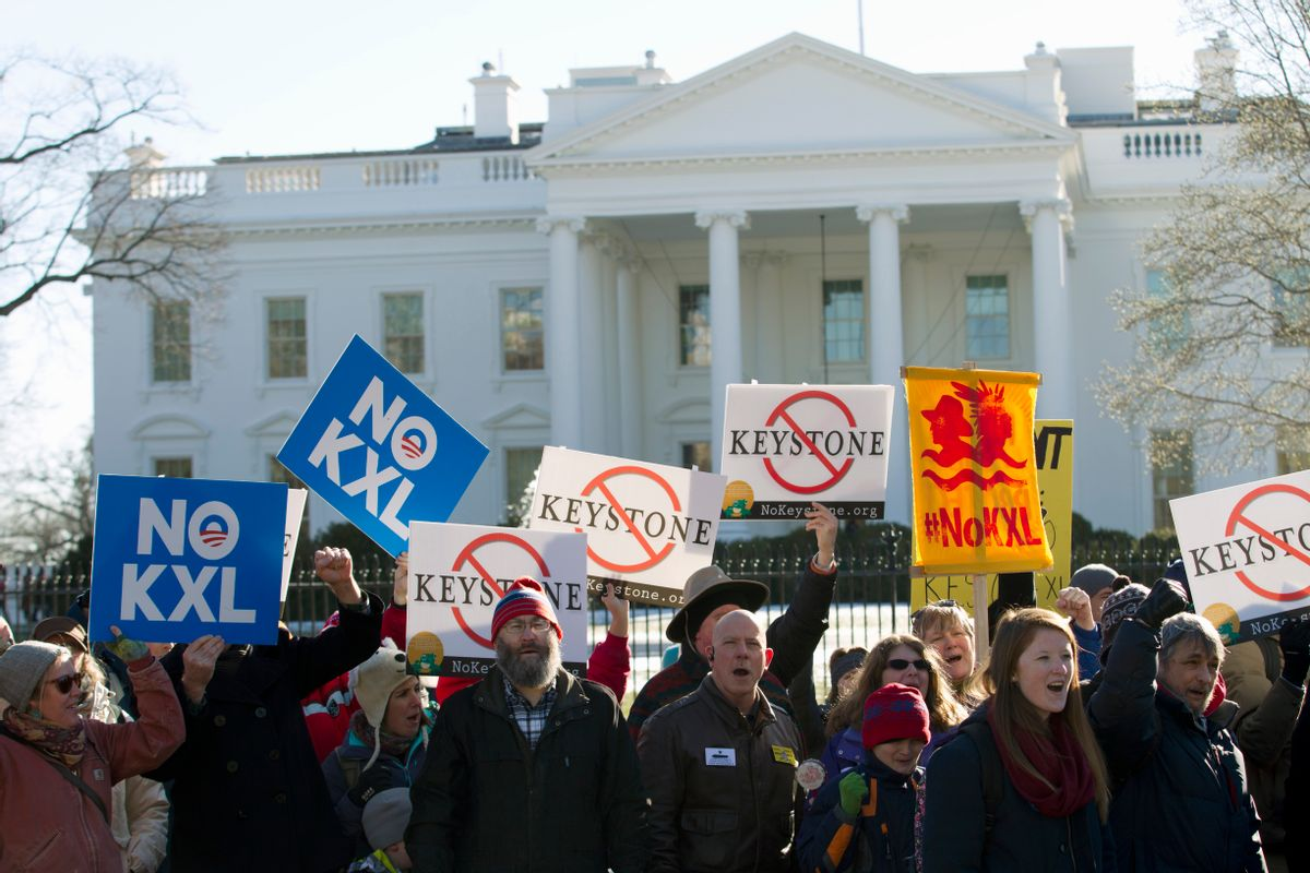 FILE - In this Jan. 10, 2015 file photo, demonstrators stand in front of the White House in Washington, during a rally in support of President Barack Obama's pledge to veto any legislation approving the Keystone XL pipeline. Supporters of the Keystone XL pipeline say the privately-funded, $8 billion project is a critically needed piece of infrastructure that will create thousands of jobs and make the U.S. dependent on oil from friends, rather than foes. Critics claim it will be disastrous for the pollution blamed for global warming and put communities along its 1,179-mile route at risk for an environmentally-damaging spill, all for oil and products that will be exported anyway. (AP Photo/Jose Luis Magana, File)   (AP)